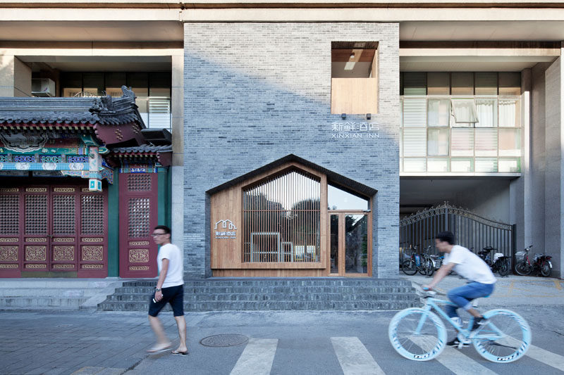 Gray Bricks And Wood, Work Together To Create A Contemporary Facade For This Small Hotel In Beijing