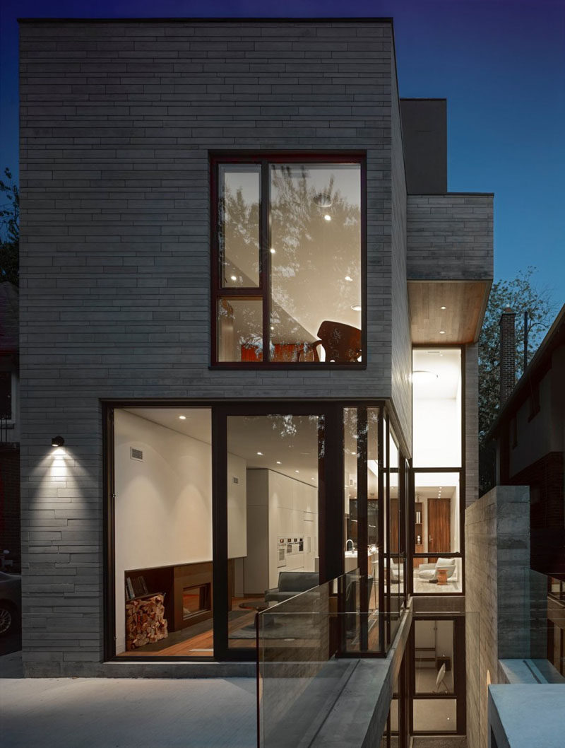 This modern house has a grey exterior with black window frames. #ModernHouse #Architecture #Windows