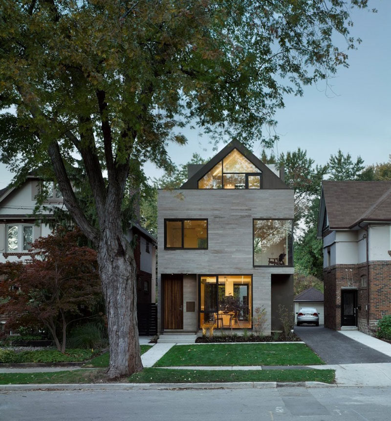 Drew Mandel Architects have designed a modern infill house in Toronto, Canada, that sits between 1920s-era single-family homes. #ModernArchitecture #ModernHouse