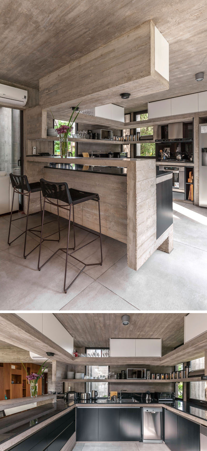 In this kitchen, black cabinets and countertops have been combined with concrete shelving to create a modern appearance. #ConcreteKitchen #BlackCabinets