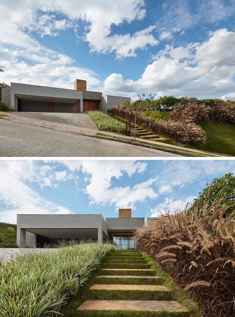 This modern house in Brazil, which sits on a slope, has stairs that are embedded into the hill and are surrounded by grass. #Landscaping #Garden #OutdoorStairs