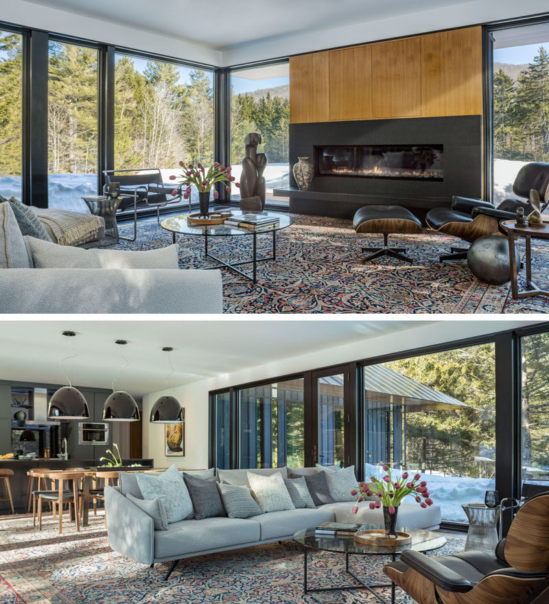 In this modern living room, a horizontal fireplace breaks up the large windows that flood the room with natural light and provide a view of the landscape. The living room also shares the space with the dining room and kitchen.