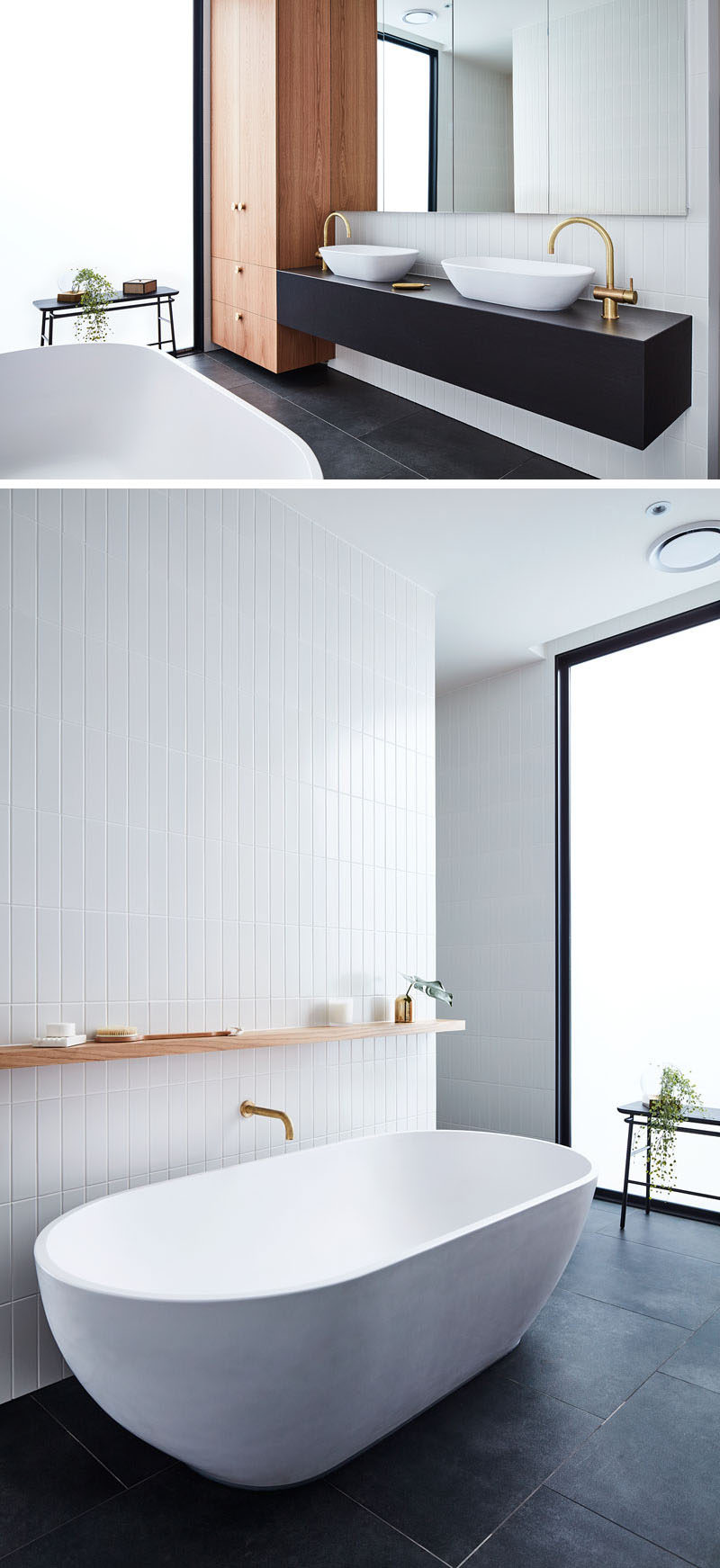 In this modern bathroom, black flooring and a black vanity contrast the white freestanding bathtub and accent tile wall, while the wood cabinets and a plant add a natural element. #ModernBathroom #BathroomDesign