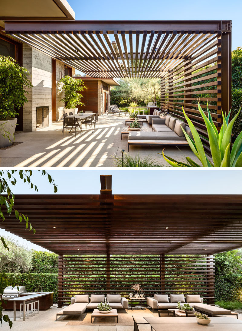 This modern house has an outdoor entertaining area with a wood and steel pergola, a fireplace and lounge area, as well as an outdoor kitchen with a bbq and dining table. #ModernPergola #OutdoorLounge #OutdoorKitchen