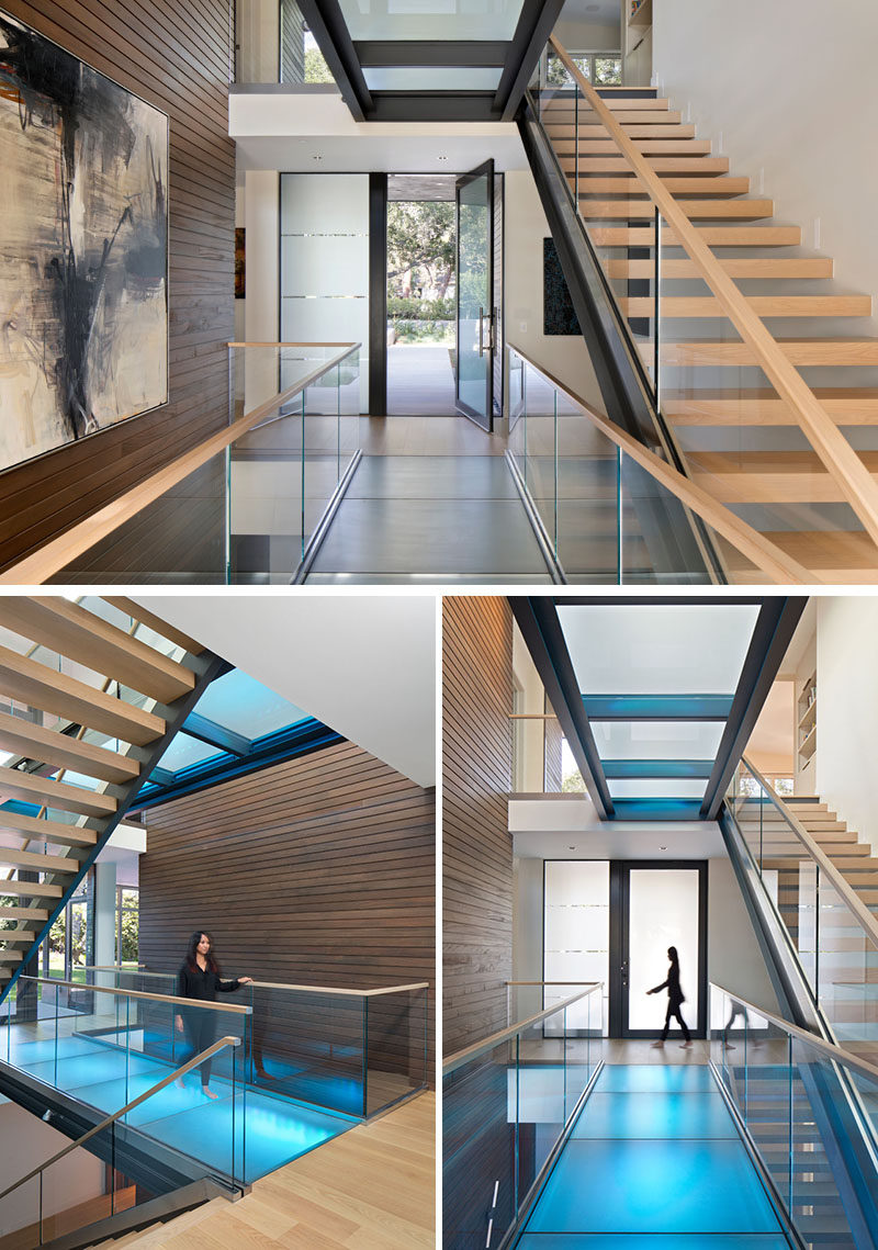 Inside this modern house, a 3-level glass bridge and open tread stair illuminates the circulation of the home. Skylights from above filter natural light down thru to the basement and LEDs light each glass bridge for a playful pop of color. #GlassBridge #Stairs #ModernHouse