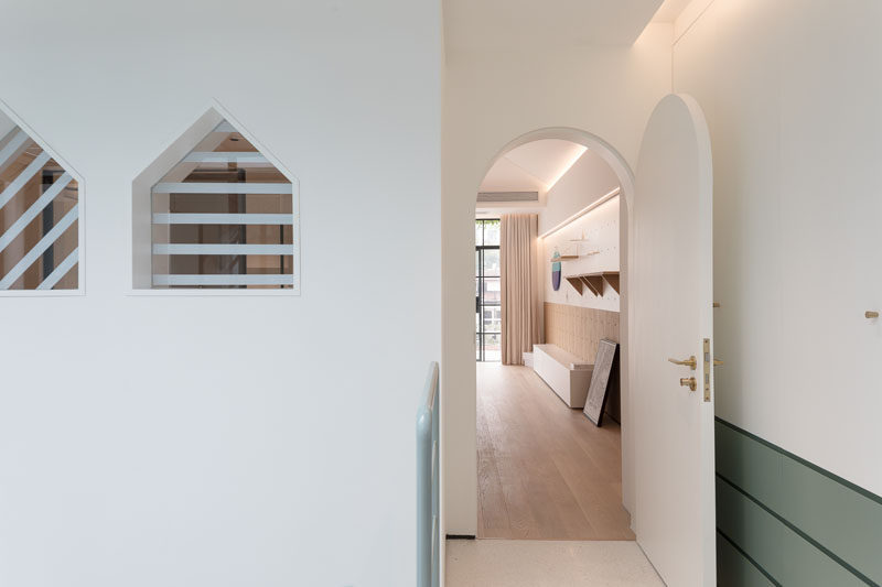 This renovated home has arched doorways and small triangle shaped windows. #ModernDoor