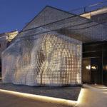 In Beijing, This Sculptural Concrete Facade Hides A Portrait Of Chairman Mao