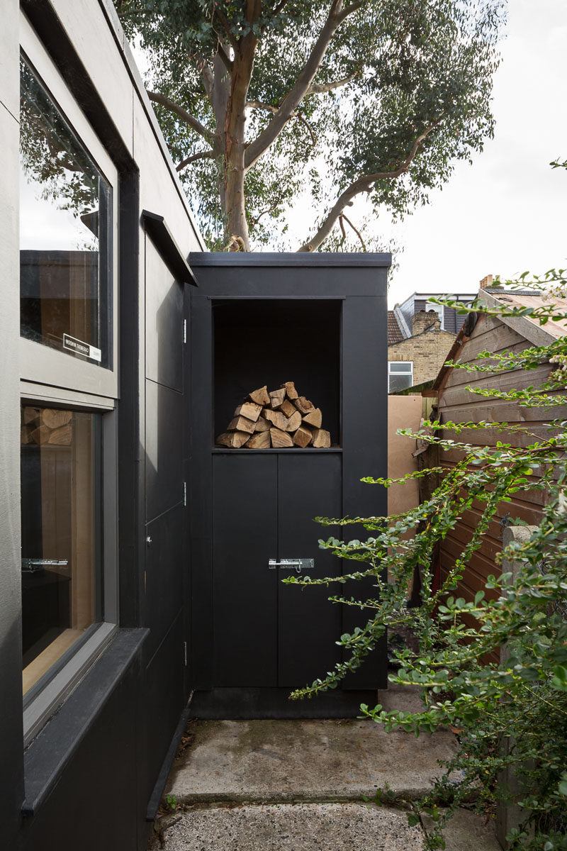This backyard pottery studio has a built-in space outside for firewood storage. #FirewoodStorage