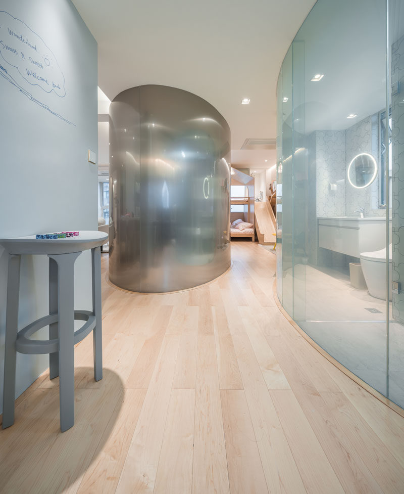 Inside, most of the walls were removed to allow light to travel throughout the interior and curved spaces have been added to create separations and form a hallway. #InteriorDesign