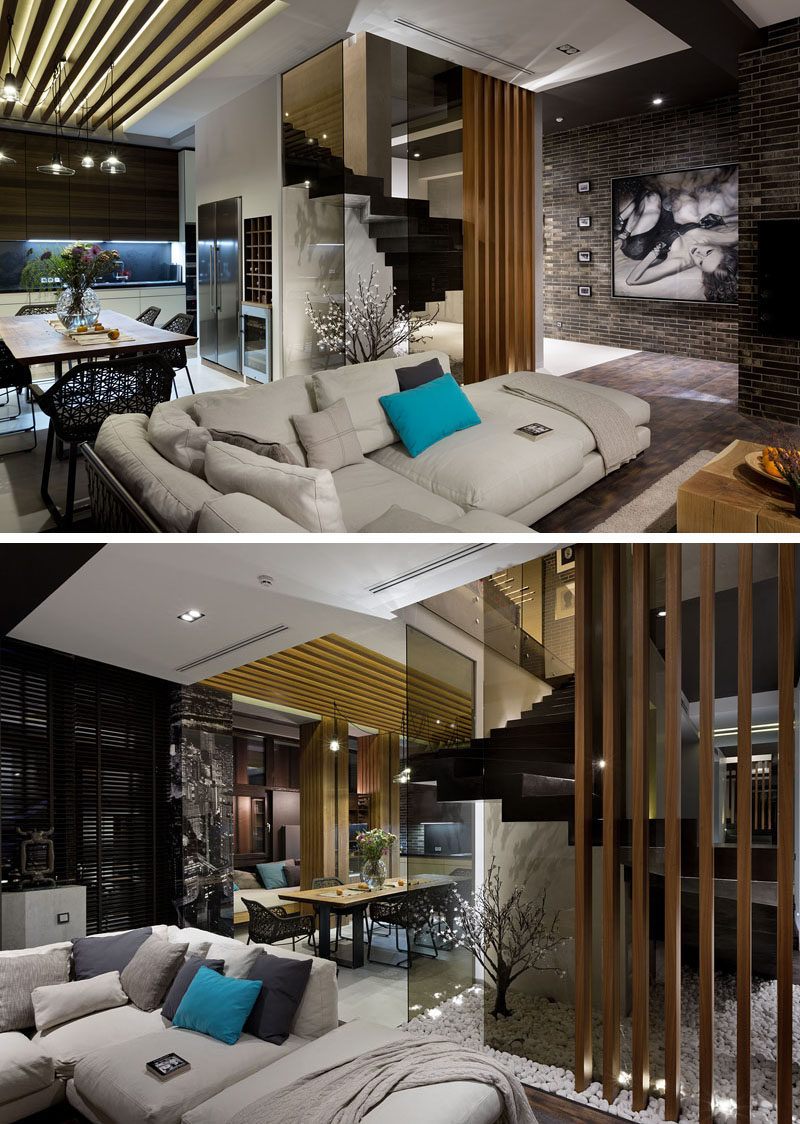 Stepping Inside This Modern Penthouse Apartment, Thereu0027s A Living Room With  Dark Brick Walls,