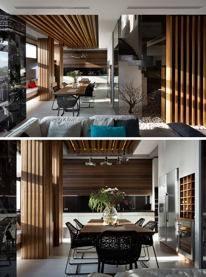 This Modern Dining Room Has A Wood Dining Table And Ceiling Feature. A  Built