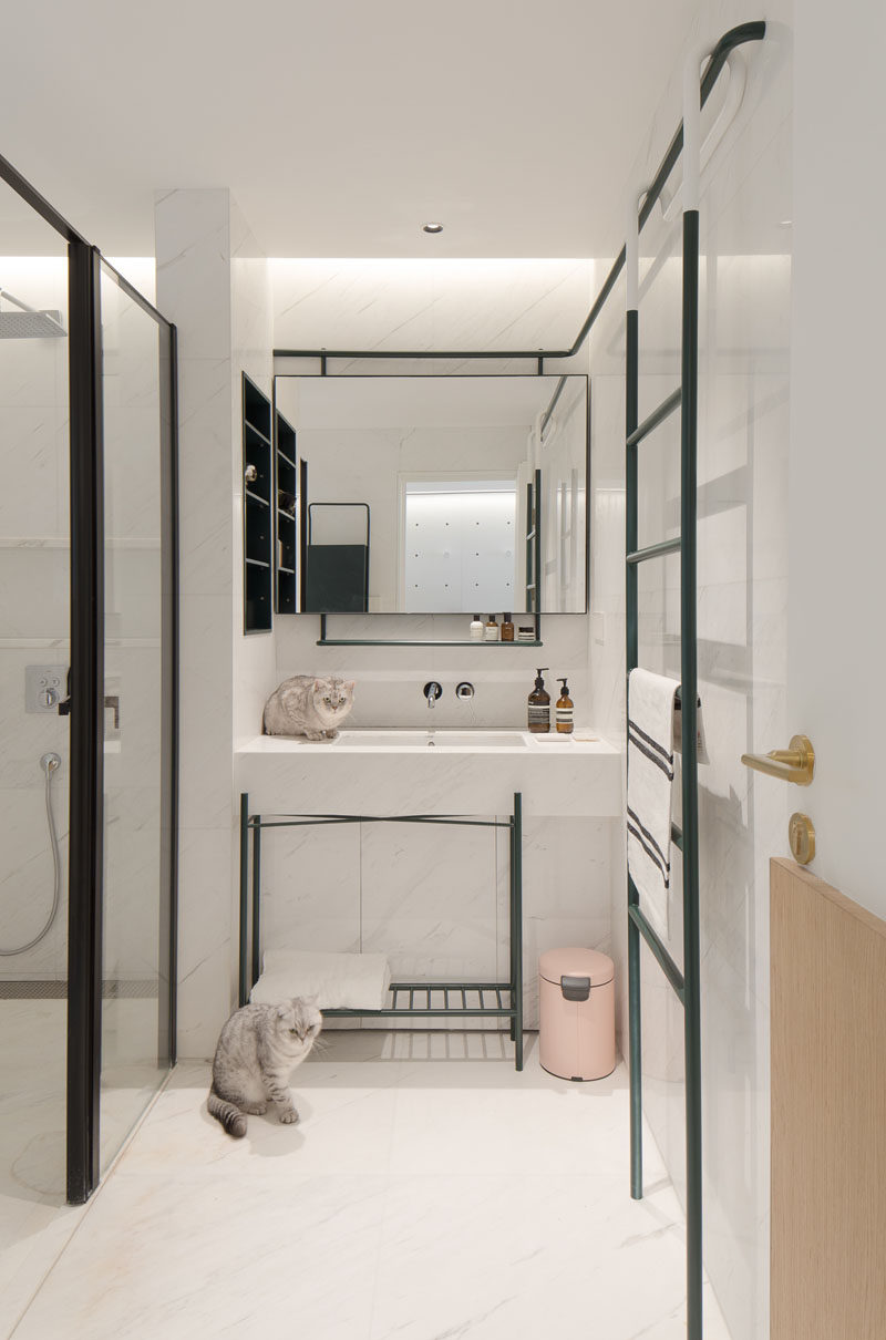 In this modern master bathroom, black accents have been used to contrast the white walls, ceiling and floor. #ModernBathroom #BathroomDesign #WhiteBathroom