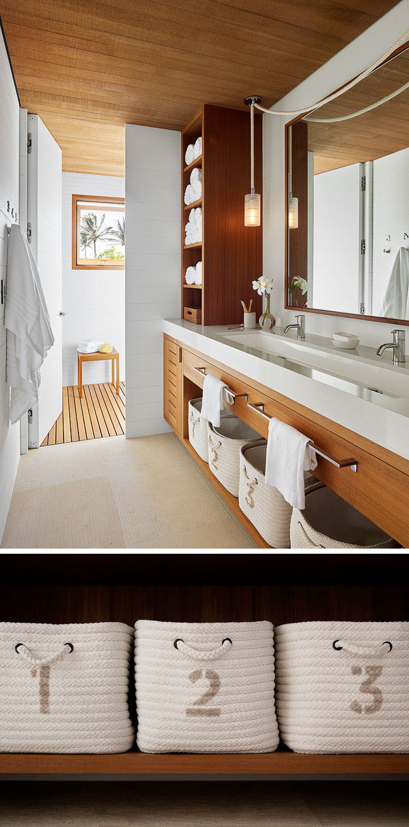 In this modern beach house bathroom, a white countertop with a long trough sink sits on a wood vanity with open shelving. #ModernBathroom #BeachHouse