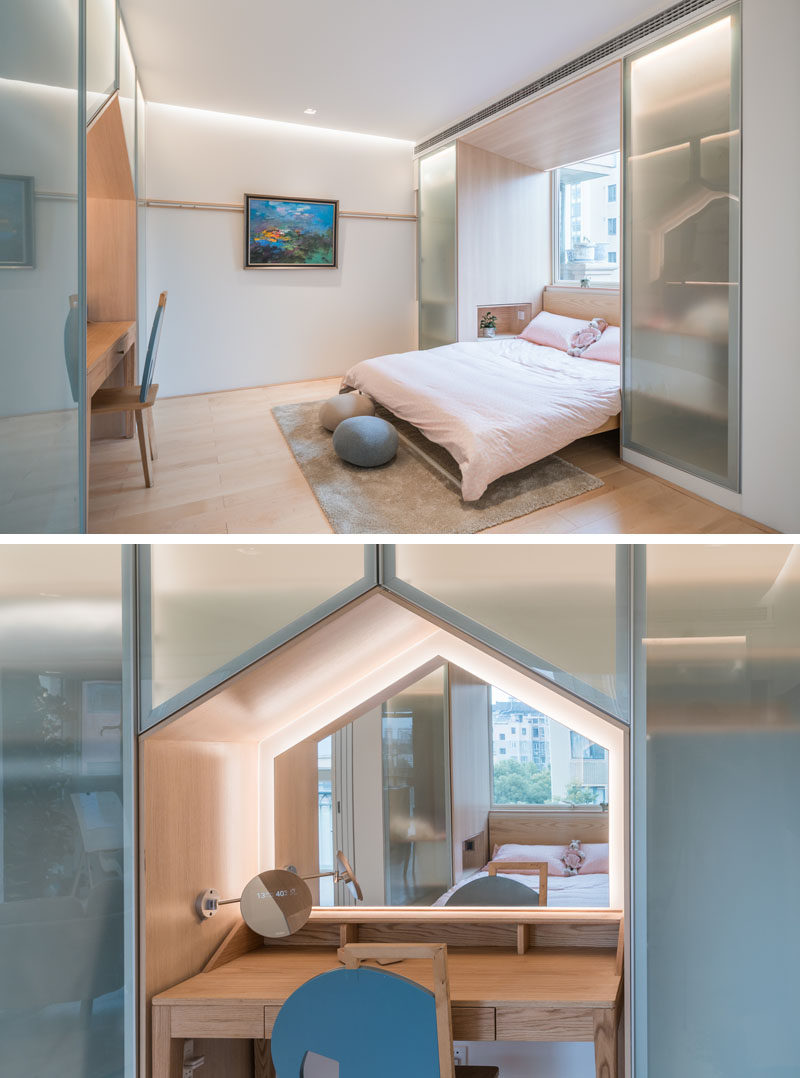 In this modern bedroom, closets either side of the bed provide storage, while built-in to the wall at the end of the bed is a vanity with a backlit mirror that reflects the light from the window. #ModernBedroom #BedroomDesign