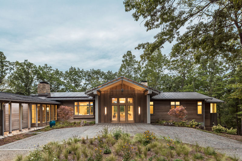 Samsel Architects have designed a modern farmhouse in Mill Spring, North Carolina, as a relaxing refuge for its owners. #ModernFarmhouse #Architecture