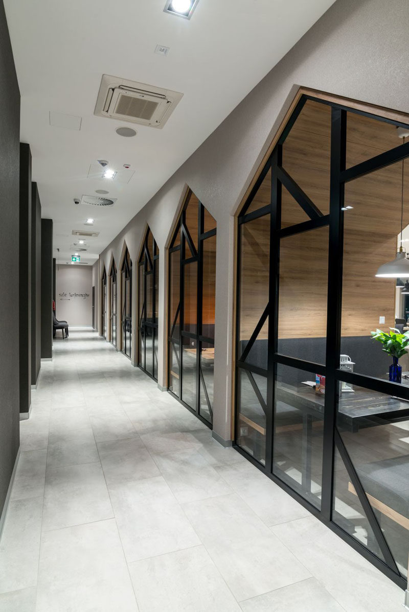 In this contemporary hotel, there's a view of the dining alcoves in the restaurant from the hallway. #HotelDesign #Windows