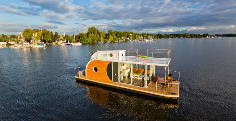 Nautilus Houseboats have designed 'Nautino Maxi', a modern houseboat that's large enough to sleep up to 6 people. #ModernHouseboat #Architecture #Design
