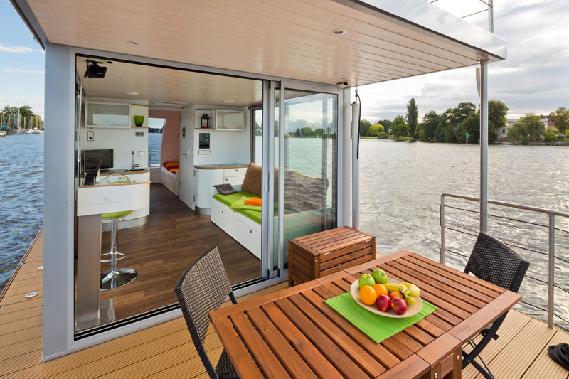 This modern houseboat has two outdoor spaces, one deck at the back of the boat and a roof top deck. #ModernHouseboat #Houseboat