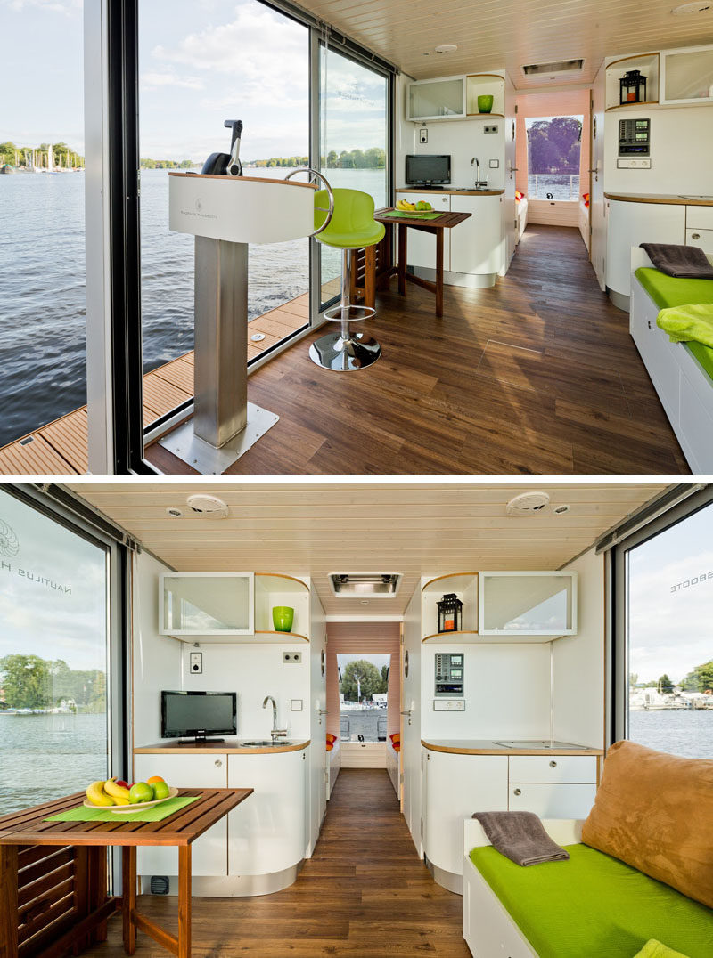 This modern houseboat has a small fitted kitchen with upper and lower cupboards, a sink unit with tap,  a fridge and a two plate hob. #ModernHouseboat #SmallKitchen