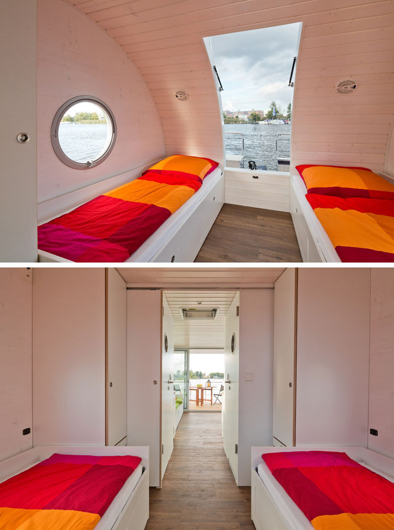 This modern houseboat has a bedroom with two beds and a pull out bed underneath. Closets at the end of the bed create additional storage space, while a curved window and portholes allow natural light to filter into the room. #ModernHouseboat #Houseboat