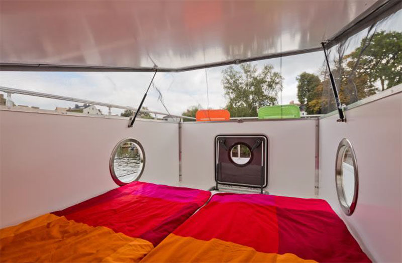 This modern houseboat has a rooftop cabin that sleeps two. #ModernHouseboat