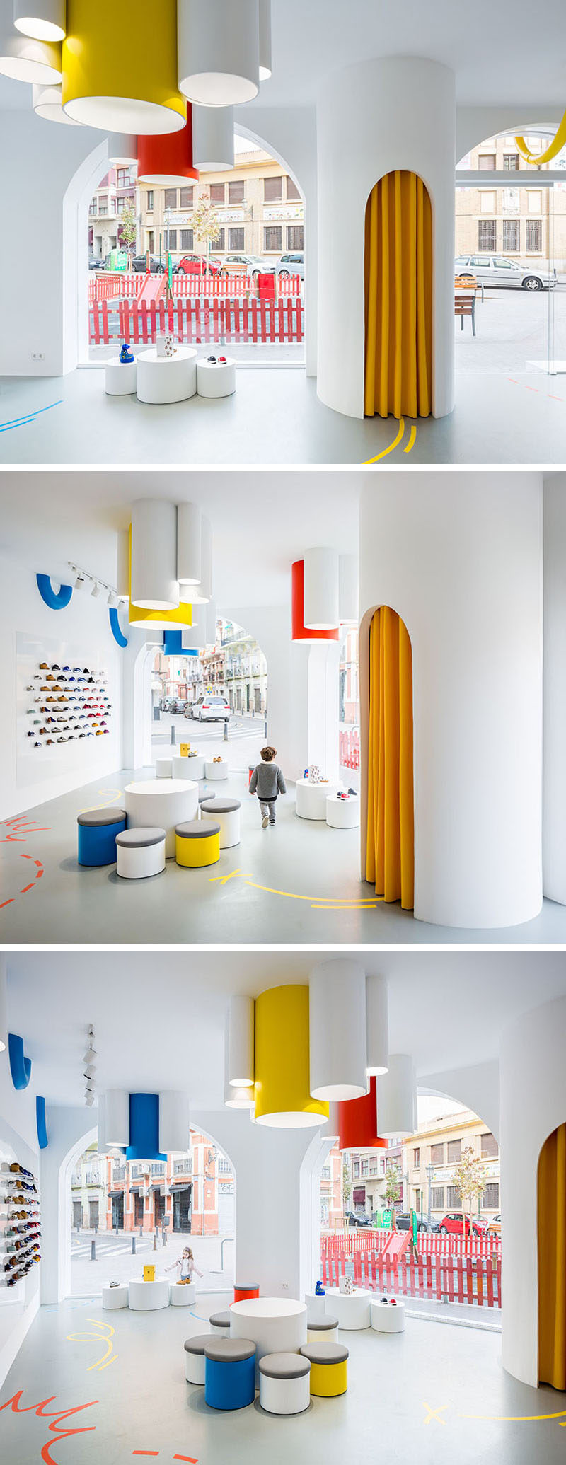 Once inside this modern retail store, the bright white interior is filled with natural light from the large windows, and additional tube lights hang from the ceiling. Pops of color are used to add a fun touch to the interior. #ModernRetailStore #KidsStore #InteriorDesign