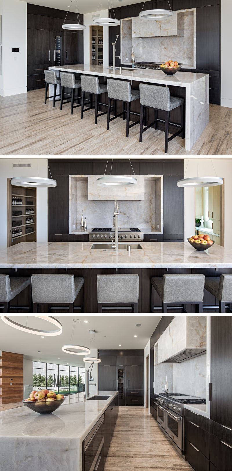 This modern kitchen has dark wood cabinets with a light colored stone countertop that's featured on the island and surrounding the stove top.