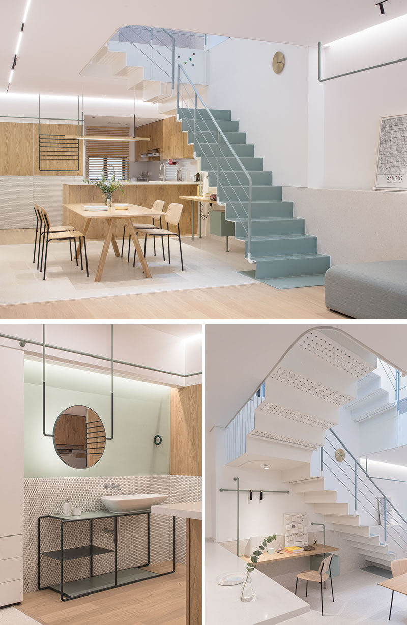 Simple light wood dining furniture keep this modern interior bright and complements the kitchen design. On one wall, there's a separate vanity area, while on the other wall and underneath the stairs is a small home office area. #ModernKitchen #InteriorDesign #HomeOffice