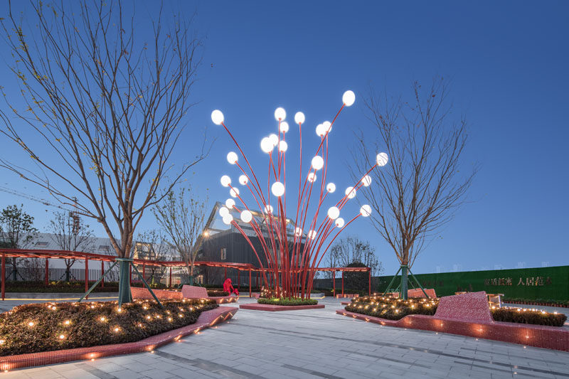 This modern public plaza has a sculpture that's designed to look like the stamen of a Pomegranate flower. #Sculpture #Art #LandscapeDesign