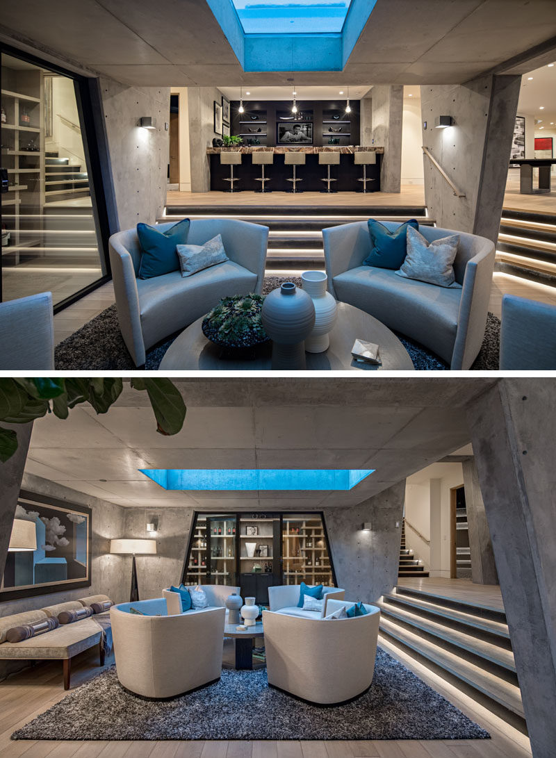 In the basement of this modern house, exposed concrete walls frame the wine room and the lounge that sit directly below the pool. #ModernLounge #ModernBar