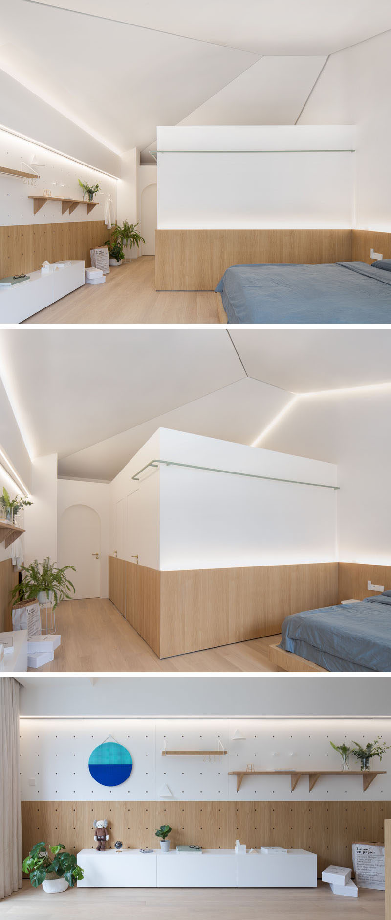 In this renovated master bedroom, the designers kept the sloped ceiling structure of the original building. Wood wraps around the lower part of the room, and on the wall opposite the bed, there's a display wall which can be changed up, much like the wall in the living room. #ModernBedroom #MasterBedroom #Shelving