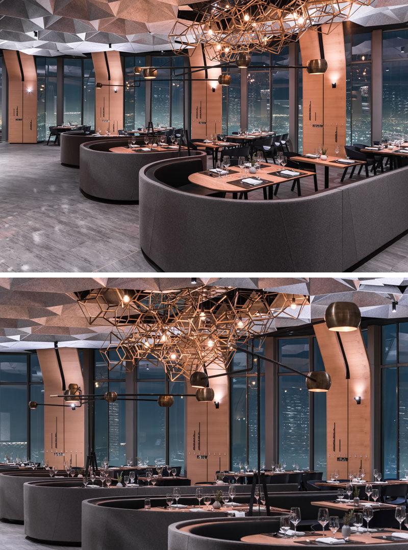 This modern restaurant has hexagonally shaped cellular coffers made of recycled plastic that help to dampen sound. #ModernRestaurant #InteriorDesign #RestaurantDesign