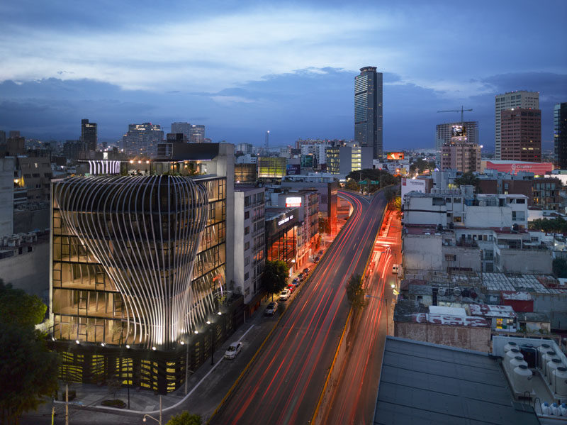 Belzberg Architects have designed a modern office building that features 272 metal fins that create a sculptural facade and travel through to the interior of the building. #Facade #Architecture