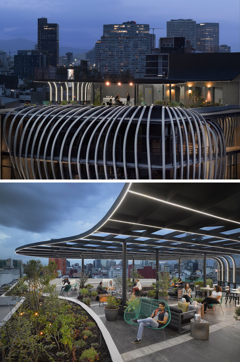 This modern office building has a sculptural facade and a rooftop patio with plenty of seating options. #ModernBuilding #Architecture #RooftopPatio