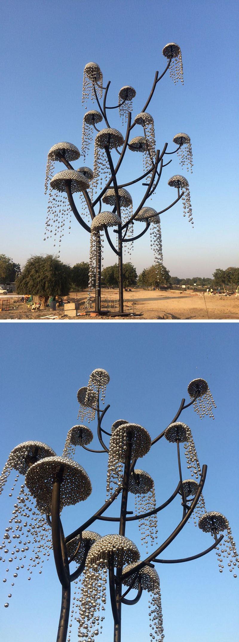 "Indian designer and artist Vibhor Sogani has designed a modern stainless steel sculpture named ""Kalpavriksha - the wish fulfilling tree"". #Sculpture #Art #PublicArt"