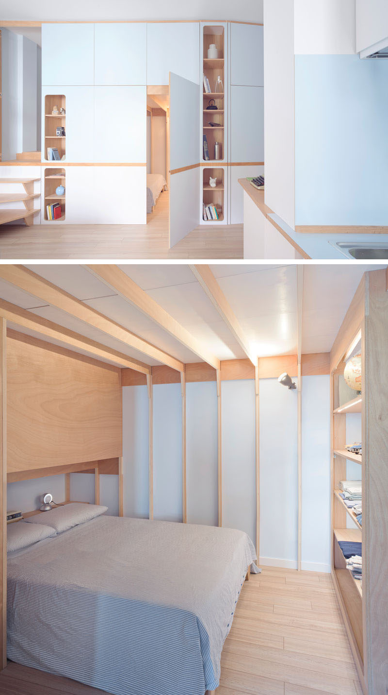 This small studio apartment has a custom designed plywood wall unit that has two sleeping areas and plenty of storage. #SmallApartment #InteriorDesign