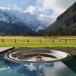 A Sunken Firepit At A Wellness Center In Slovenia Has Views Of The Kamnik-Savinja Alps