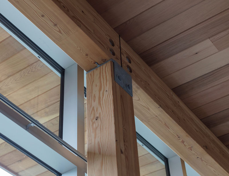 Here's a closer look at the wood posts and beams that have been used through the structure of a modern house. #Architecture