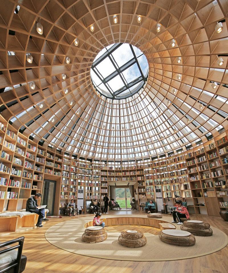 Inside this visitors centre in China, there's a library where local children can visit to read and play. In the middle of the library is a sunken living space, giving visitors a chance to sit and relax. #Library #Architecture #Shelving