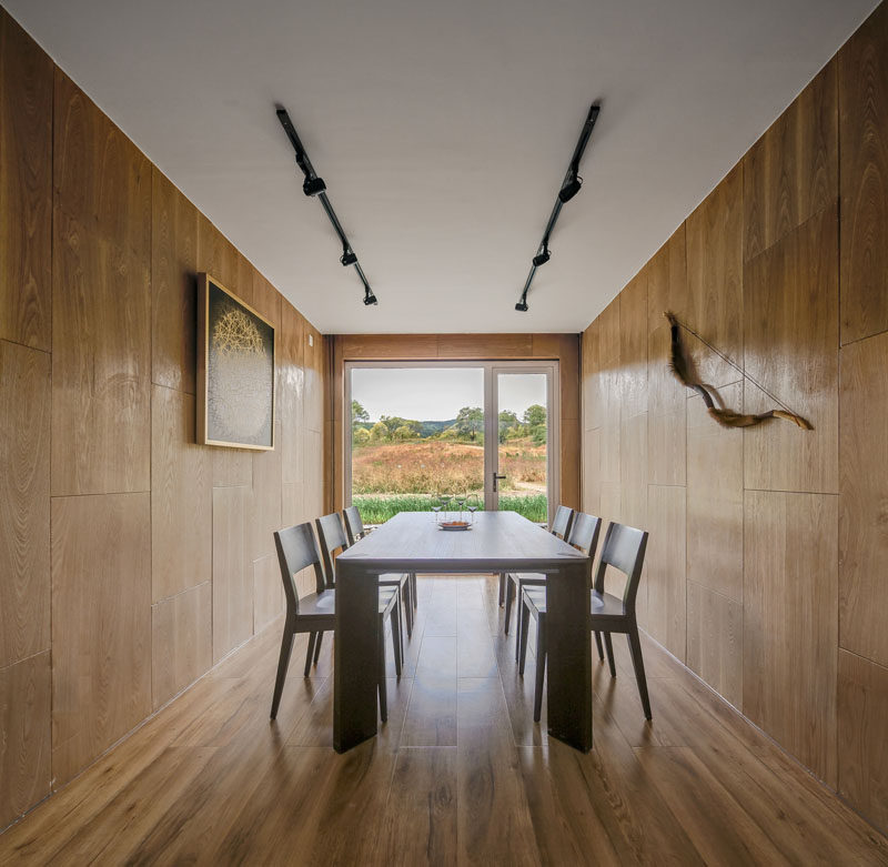 This wood-lined dining area has views of surrounding landscape. #DiningRoom #Wood