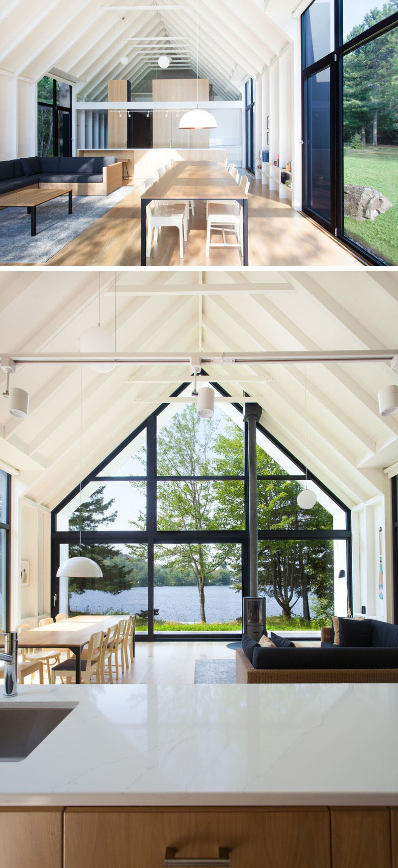 In the main living area of this modern vacation house, there's a kitchen, living area and dining area, that features a wall of glass that looks out to the lake and a large double-height gable extending outward to cover a small porch. #VacationHouse #Windows #InteriorDesign