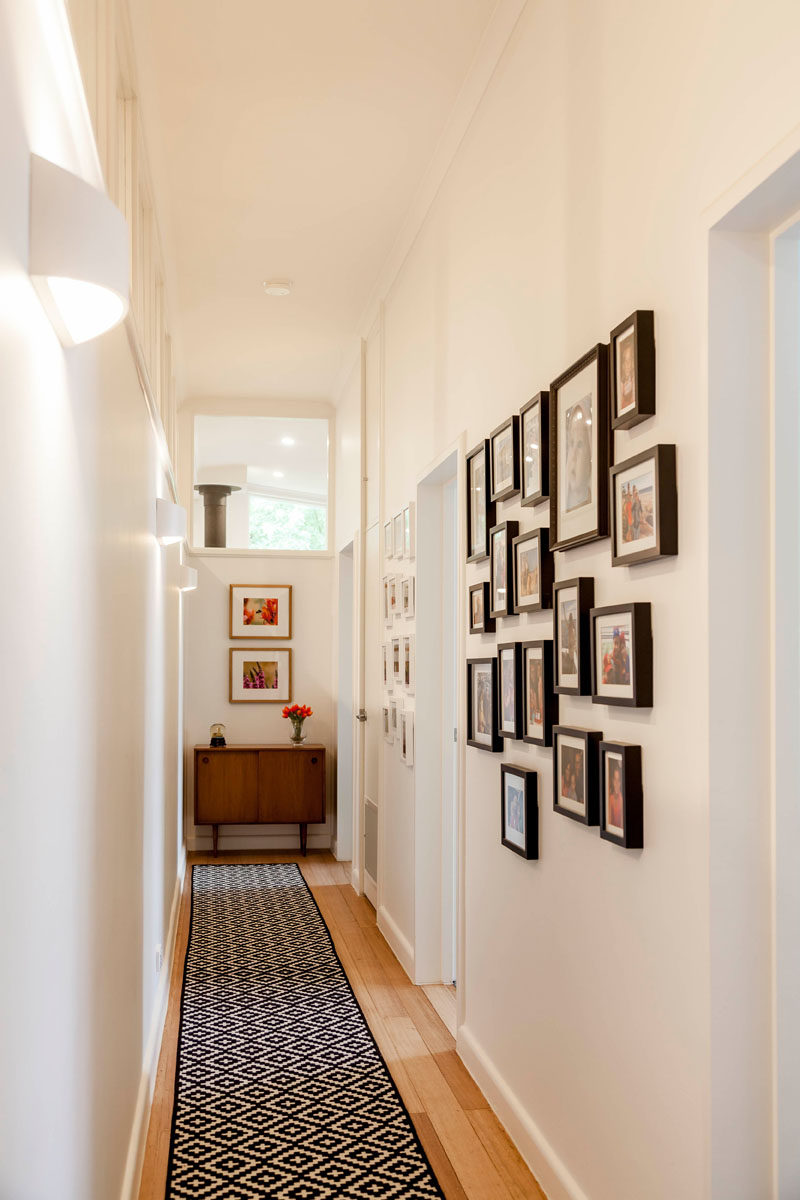 Mid-century modern elements have been kept in this renovated home, like the cabinet at the end of this hallway that leads to the children's bedrooms. #MidCenturyModern #Hallway