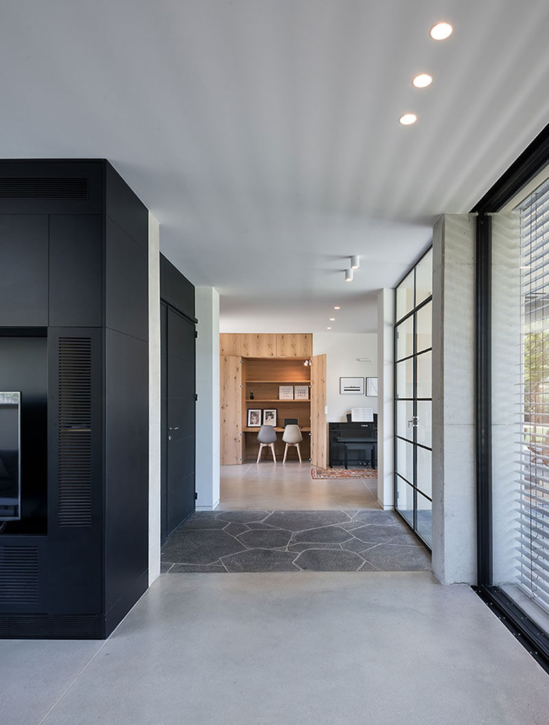 This modern house has a small desk area that's tucked away into a closet. #HiddenDesk