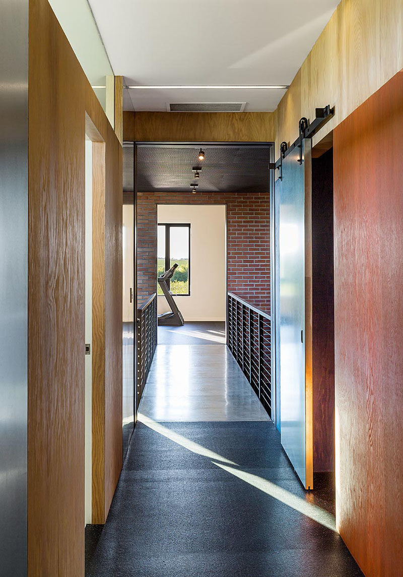 This industrial modern house has a bridge that separates the two wings of the house. #ModernHouse #InteriorBridge
