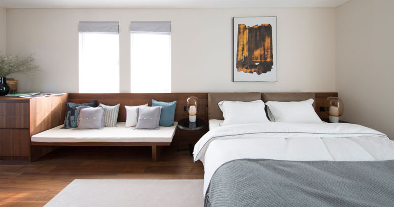 Design Detail - This Bedroom Design Includes A Headboard With A Built-In Bench And Set Of Drawers