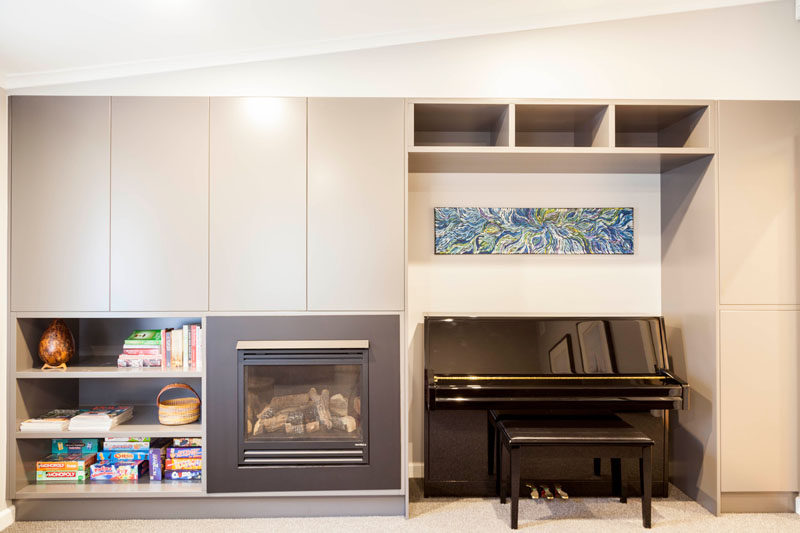 In this contemporary media room, there's built-in joinery to create storage and a gas fireplace adds warmth to the room. #Storage #Fireplace