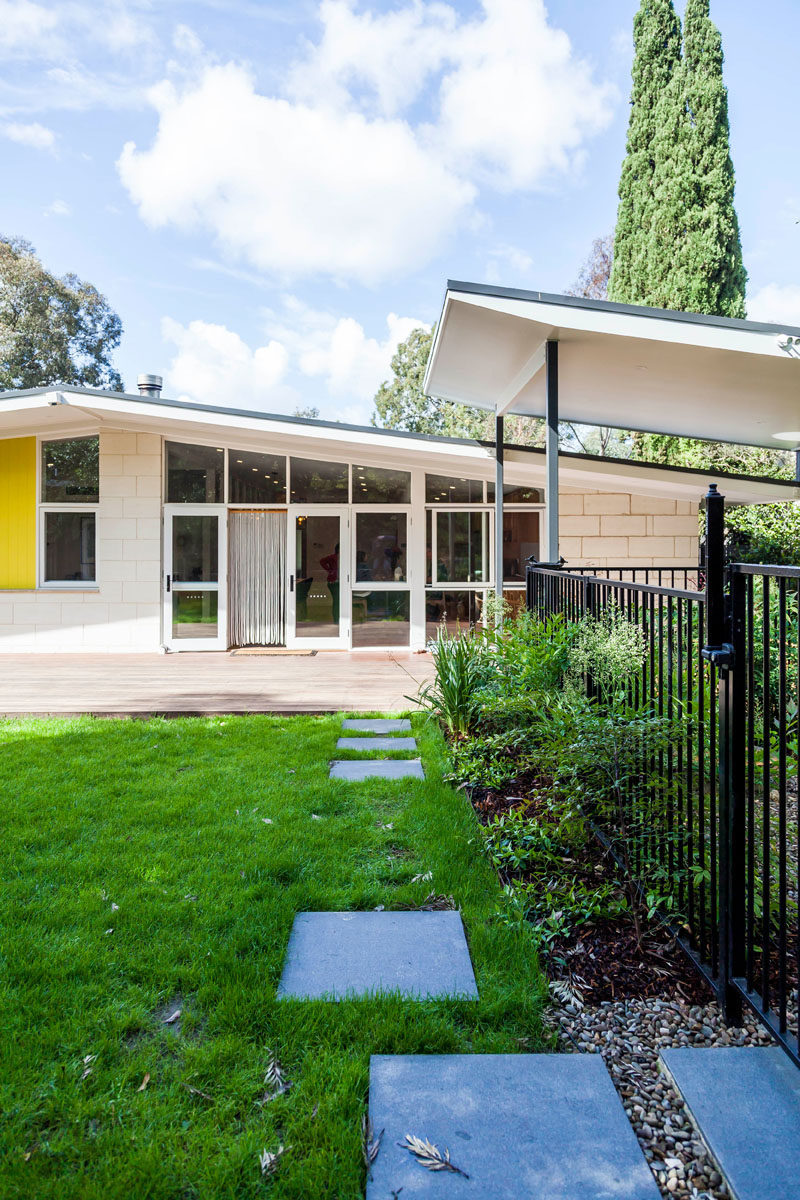 This renovated mid-century modern house has a landscaped backyard and a large deck for entertaining. #Backyard #Deck