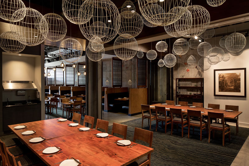 Lantern-like lighting and murals inspired by aged oriental carpets add to the Southern Asia feeling found throughout the interior of this contemporary restaurant. #RestaurantDesign #
