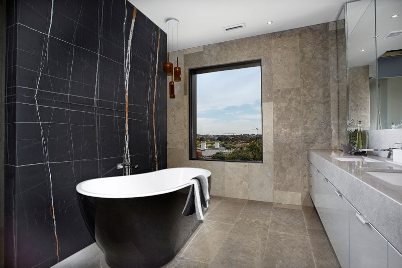 In the master ensuite bathroom there's a freestanding bath tub and double bowl vanity unit. Floor to ceiling marble and stone completes the theme of a luxury hotel retreat. #ModernBathroom