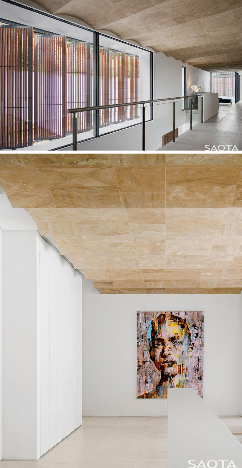 Inside this modern house, there's a gallery-like space with signature barrel vaulted ceilings. #VaultedCeiling #InteriorDesign